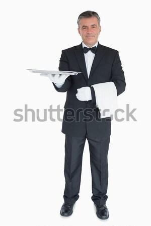 Sorridente garçom fora prata bandeja Foto stock © wavebreak_media