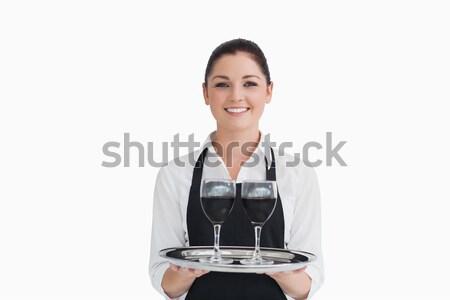 Pincérnő tart borospoharak ezüst tálca boldog Stock fotó © wavebreak_media