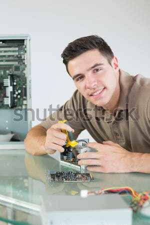 Számítógép mérnök dolgozik processzor hívás fiatal Stock fotó © wavebreak_media