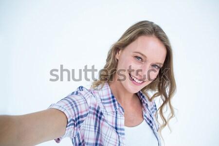 Portrait of smiling young woman holding spray bottle Stock photo © wavebreak_media
