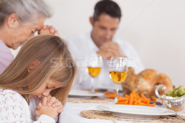 Little girl saying grace with family  Stock photo © wavebreak_media