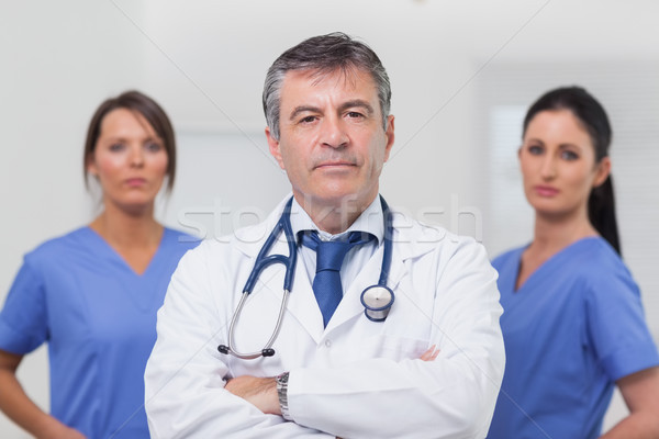 Doctor and his team of nurses Stock photo © wavebreak_media