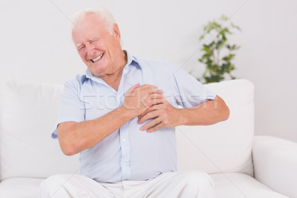 Old man suffering with heart pain Stock photo © wavebreak_media