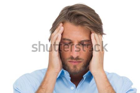 Handsome man touching his temples to calm a headache Stock photo © wavebreak_media