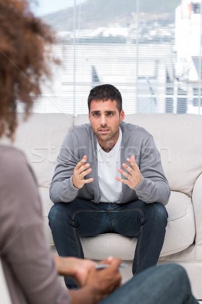 Upset man speaking to a therapist Stock photo © wavebreak_media