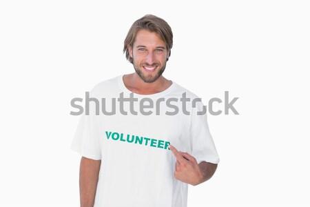 Férfi mutat önkéntes póló fehér póló Stock fotó © wavebreak_media