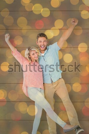 Stock photo: Composite image of casual couple lying on floor