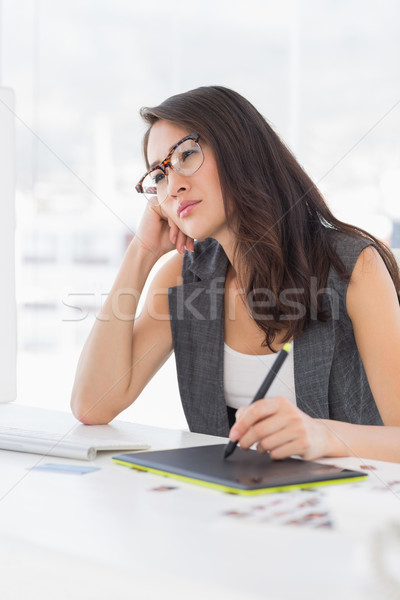 Concentrated casual photo editor using graphics tablet Stock photo © wavebreak_media