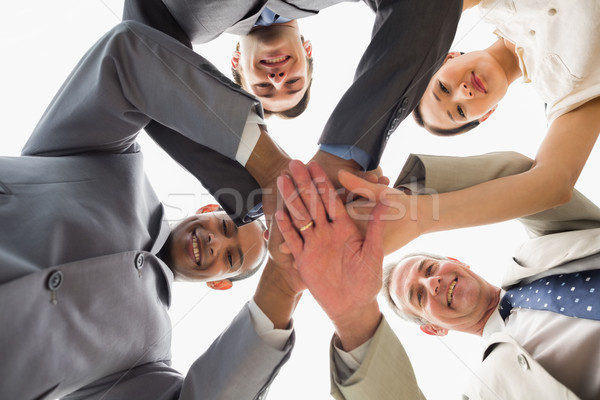 üzleti csapat lefelé néz kamera kezek együtt iroda Stock fotó © wavebreak_media