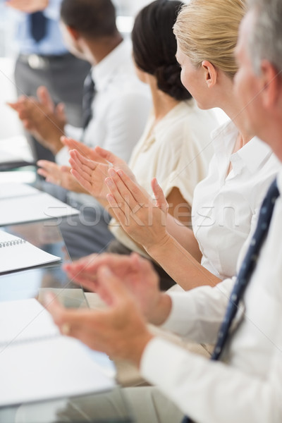 Business people clapping colleague at a meeting Stock photo © wavebreak_media