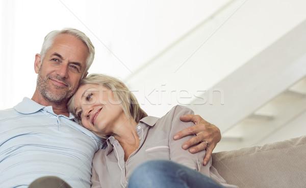 Relaxed mature couple sitting on sofa Stock photo © wavebreak_media