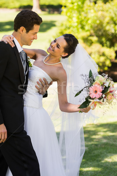 Romantic newlywed couple standing in park Stock photo © wavebreak_media