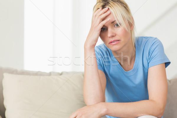 Endişeli genç kadın oturma oturma odası ev kadın Stok fotoğraf © wavebreak_media