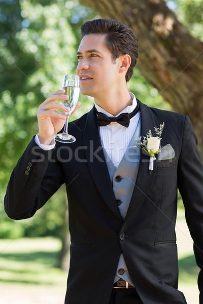 Thoughtful bridegroom drinking champagne Stock photo © wavebreak_media