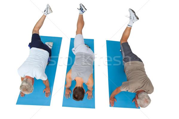 Teljes alakos három férfiak testmozgás fehér férfi Stock fotó © wavebreak_media