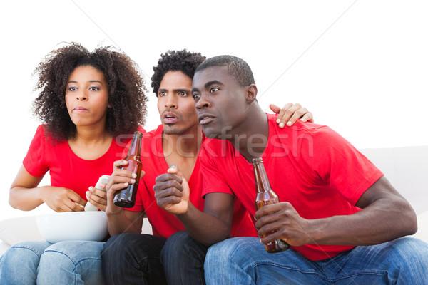 Nerwowy piłka nożna fanów czerwony sofa biały Zdjęcia stock © wavebreak_media