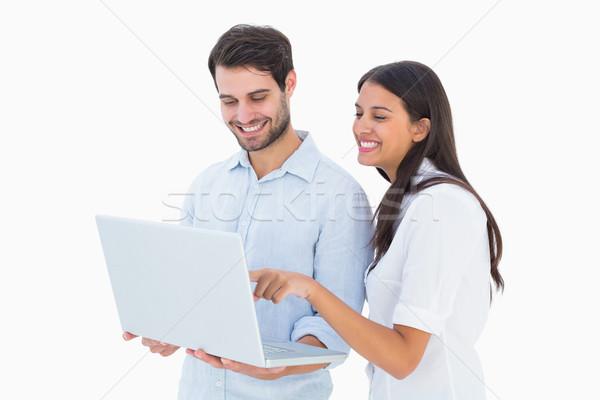 Atractivo portátil blanco ordenador Foto stock © wavebreak_media