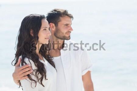 Cute couple embracing with eyes closed Stock photo © wavebreak_media