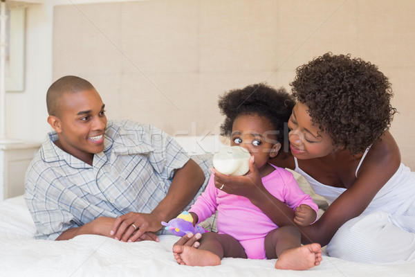 Happy parents with baby girl on their bed Stock photo © wavebreak_media