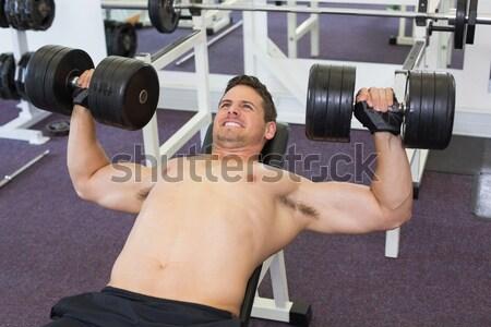 Sin camisa muscular hombre pesas Foto stock © wavebreak_media