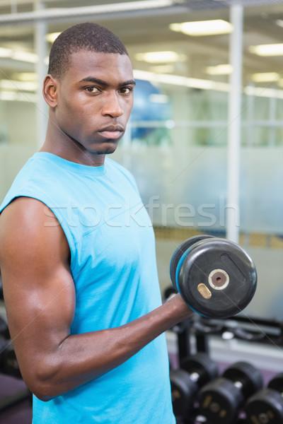 Portré fiatalember testmozgás súlyzó tornaterem fiatal Stock fotó © wavebreak_media