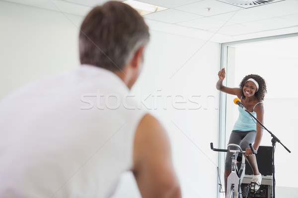 Stock photo: Spinning instructor motivating her class