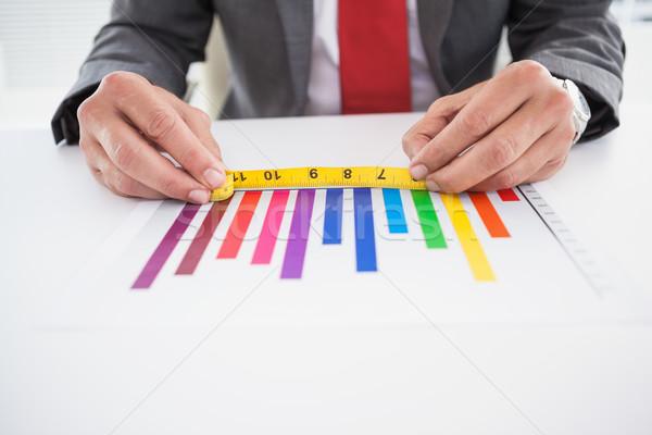 Businessman measuring graph with tape Stock photo © wavebreak_media