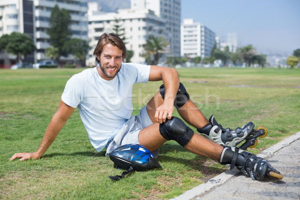 Fit man getting ready to roller blade Stock photo © wavebreak_media