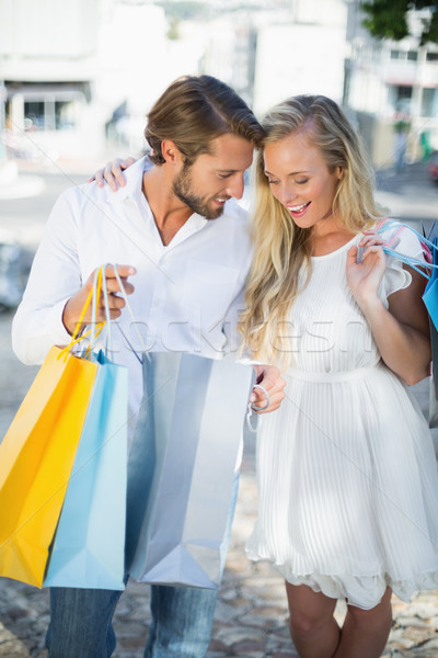 Attractive couple looking at shopping purchases Stock photo © wavebreak_media