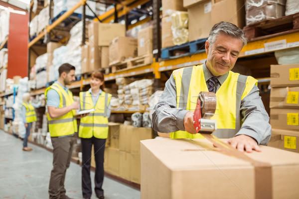 Magazijn werknemer karton dozen scheepvaart groot Stockfoto © wavebreak_media