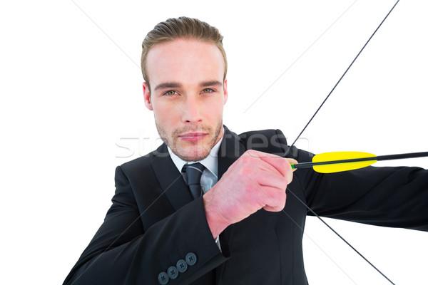 серьезный бизнесмен съемки лук стрелка белый Сток-фото © wavebreak_media