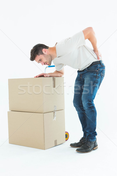 Delivery man with cardboard box suffering from back ache Stock photo © wavebreak_media