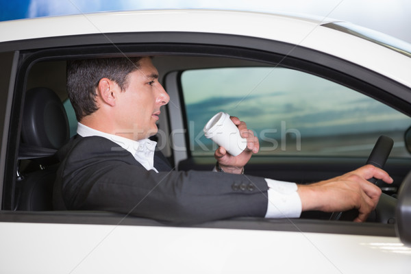 Komoly üzletember iszik kávé vezetés autó Stock fotó © wavebreak_media