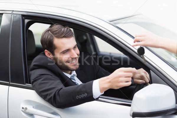 Biznesmen posiedzenia siedziba samochodu działalności okno Zdjęcia stock © wavebreak_media