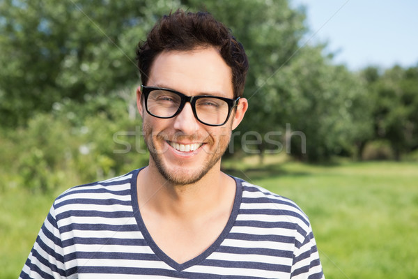 Handsome hipster smiling at camera Stock photo © wavebreak_media