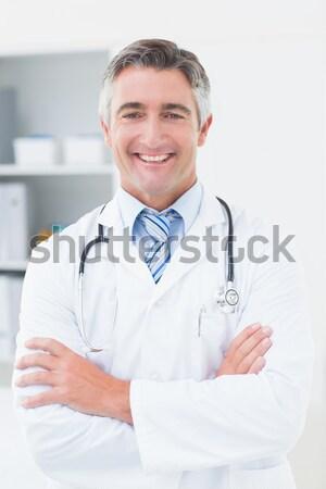 Orvos telefon klinika portré boldog férfi Stock fotó © wavebreak_media