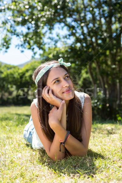 Pretty brunette thinking on the grass Stock photo © wavebreak_media