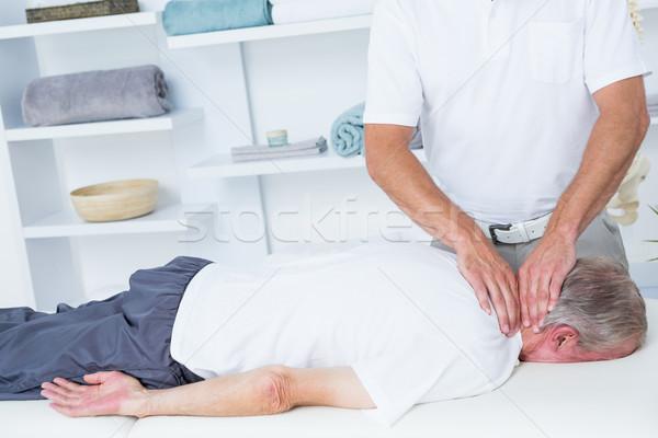 Cuello masaje paciente médicos oficina hombre Foto stock © wavebreak_media