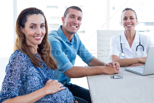 Médecin avenir parents souriant caméra médicaux Photo stock © wavebreak_media
