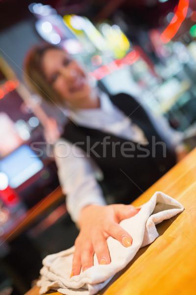 Pretty barmaid wiping down bar Stock photo © wavebreak_media