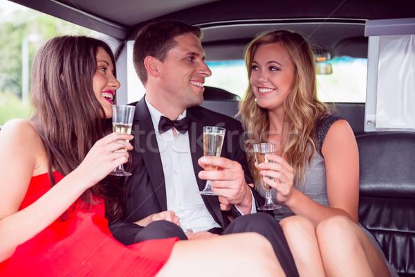 Gelukkig vrienden drinken champagne limousine Stockfoto © wavebreak_media