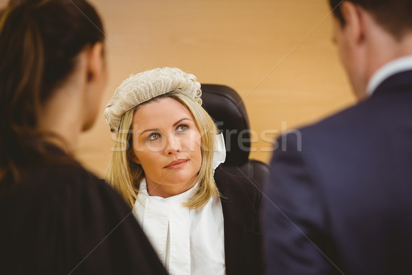 Judge and lawyer listening the criminal in handcuffs Stock photo © wavebreak_media
