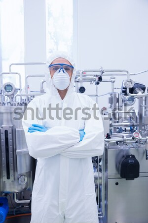 Scientist in protective suit standing with arms crossed Stock photo © wavebreak_media