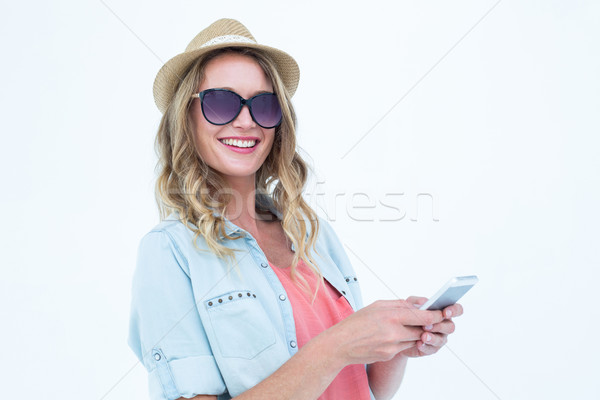Smiling woman texting with her smartphone  Stock photo © wavebreak_media