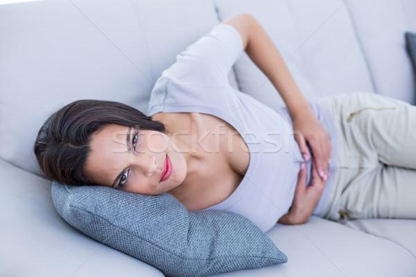 Stock photo: Sick brunette having stomachache