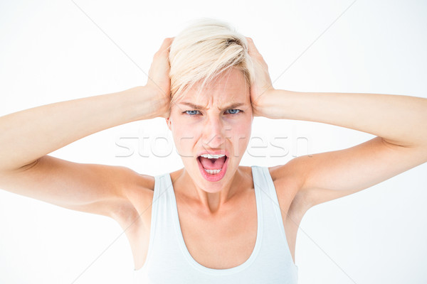 Angry woman screaming and holding her head  Stock photo © wavebreak_media
