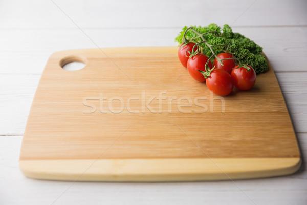 Tagliere pomodori prezzemolo shot studio cucina Foto d'archivio © wavebreak_media