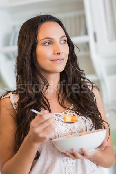 Pretty brunette  eating a fruits salad  Stock photo © wavebreak_media