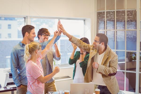 Happy business team doing hands checks Stock photo © wavebreak_media