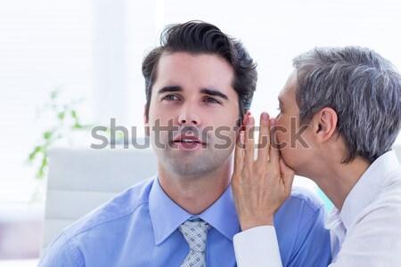 Due uomini d'affari guardando carta lavoro cartella Foto d'archivio © wavebreak_media
